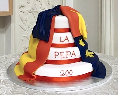 La Pepa Cake draped in the Spanish and EU Flags