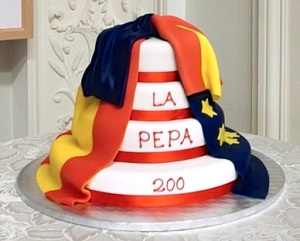 La Pepa Cake draped in the Spanish and EU Flags