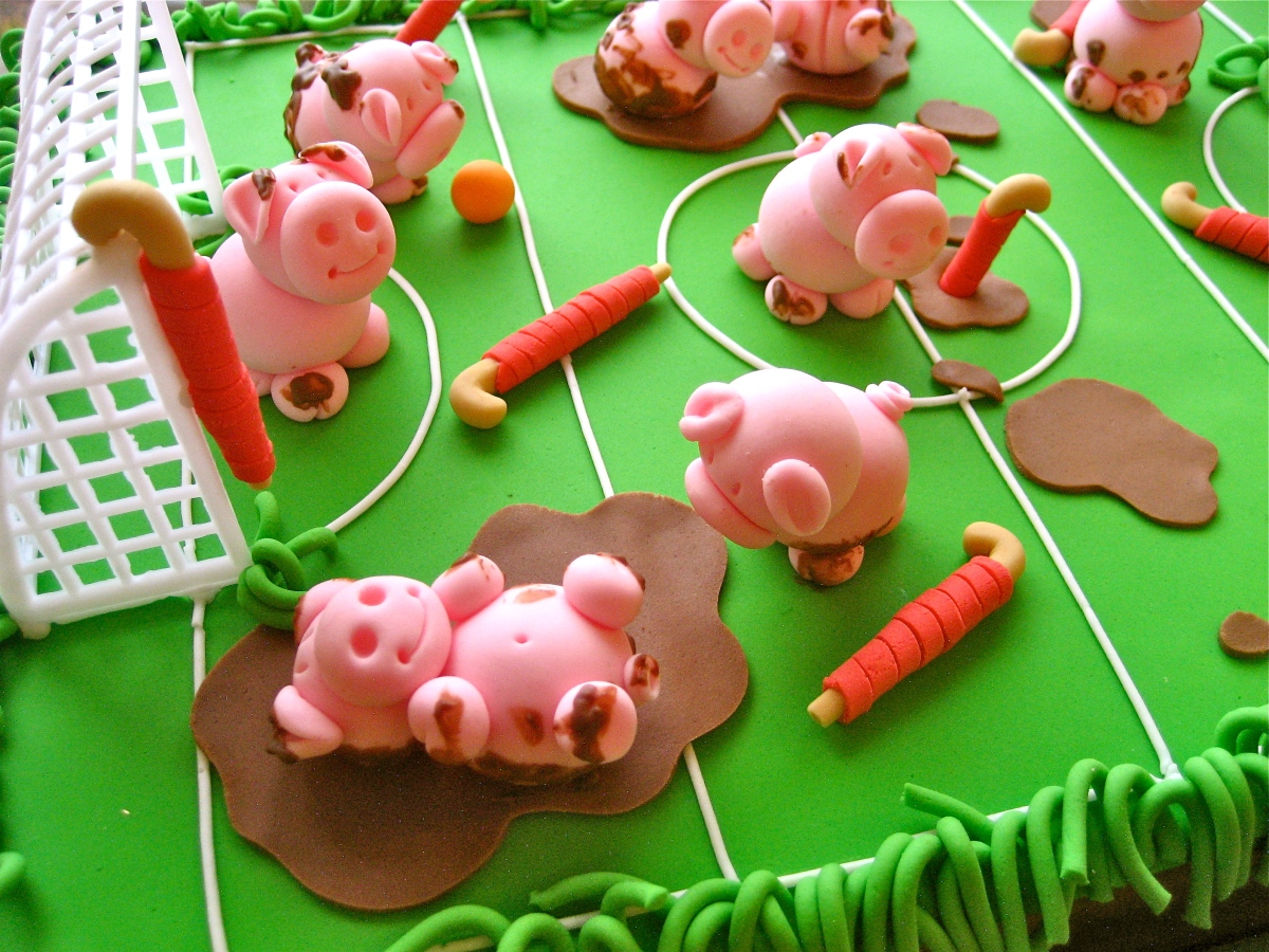 Little Pigs Playing Hockey